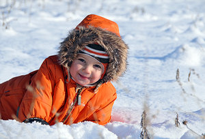 kid in snow - Copyright – Stock Photo / Register Mark