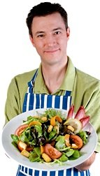 Man holding large salad. - Copyright – Stock Photo / Register Mark