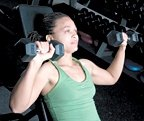 Chelsea Cooper performing incline dumbbell chest press. - Copyright – Stock Photo / Register Mark