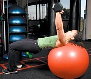 Chelsea Cooper performing stability ball barbell press. - Copyright – Stock Photo / Register Mark