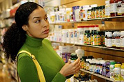 Woman shopping for supplements.
