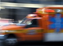 An ambulance speeding by. - Copyright – Stock Photo / Register Mark