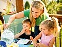 Mother and two children enjoy a meal. - Copyright – Stock Photo / Register Mark