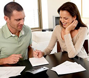 Couple go over thier health plan. - Copyright – Stock Photo / Register Mark