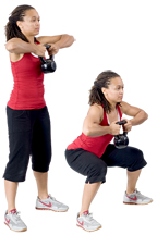 Personal trainer Chelsea Cooper domonstrates The Squat with a Kettlebell. - Copyright – Stock Photo / Register Mark
