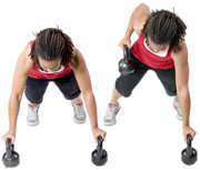 Personal trainer Chelsea Cooper domonstrates a Renegade Row with Kettlebells. - Copyright – Stock Photo / Register Mark