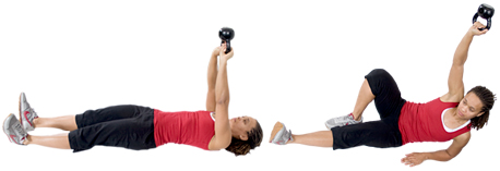 Personal trainer Chelsea Cooper domonstrates a Turkish Get-Up with a Kettlebell. - Copyright – Stock Photo / Register Mark