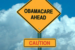 obamacare caution sign - Copyright – Stock Photo / Register Mark