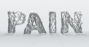 The word pain spelled out with barbed wire.