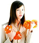 A young woman holding dumbbell weights.