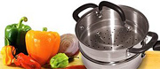Collection of various types of peppers and a steamer pot. - Copyright – Stock Photo / Register Mark