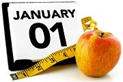 A daily calendar, a tape measure and an apple. - Copyright – Stock Photo / Register Mark