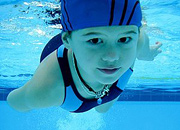 Young girl swimming underwater. - Copyright – Stock Photo / Register Mark