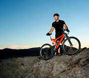 Athlete standing with mountain bike.