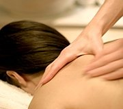Woman receiving massage. - Copyright – Stock Photo / Register Mark